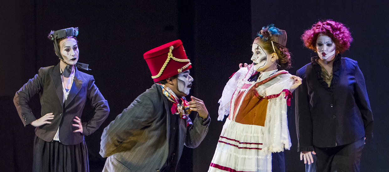 Actors with expressive makeup perform on stage